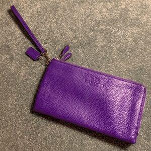 USED ONCE, LIKE NEW** Large purple coach wristlet
